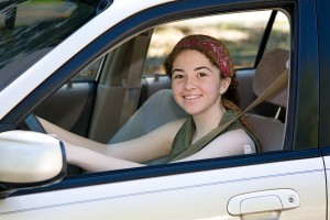 Happy teen driver taking driver education